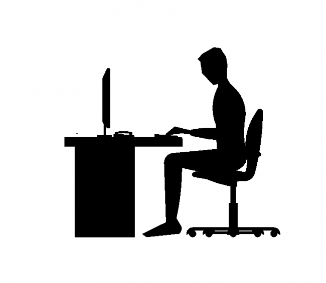 A silhouette of a person in front of computer